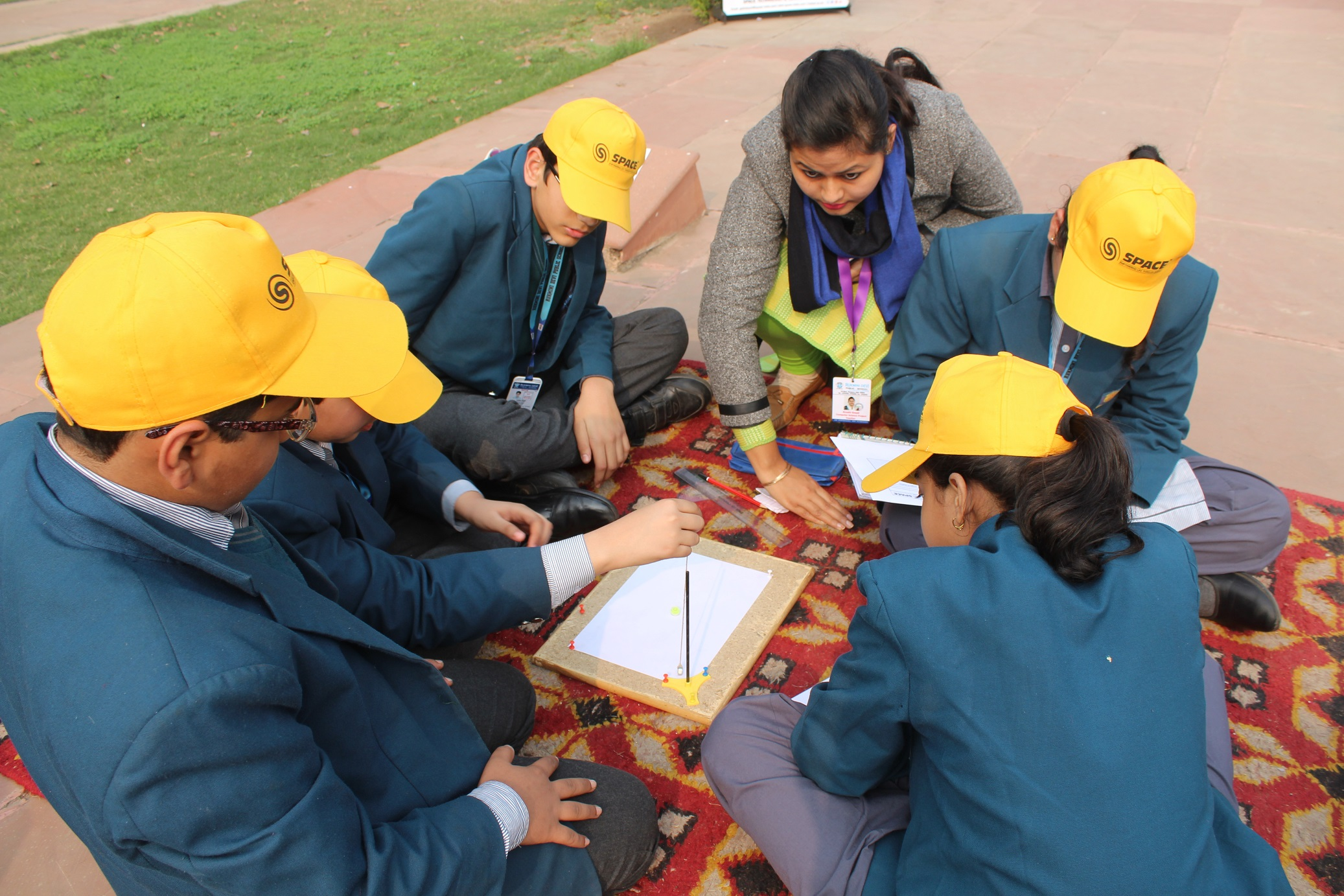 Students performing the experiment
